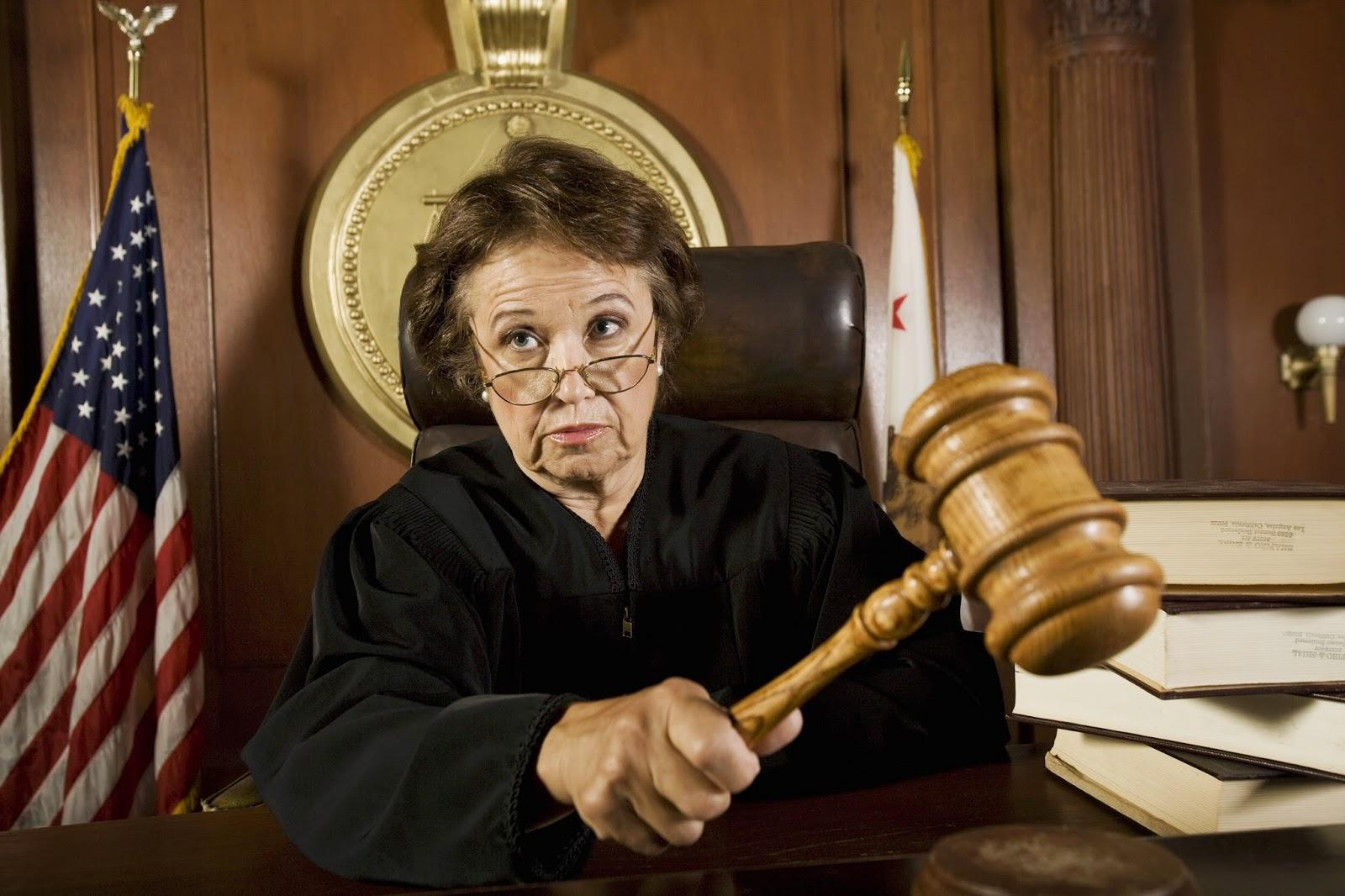 older+female+judge+with+gavel - The DI Wire